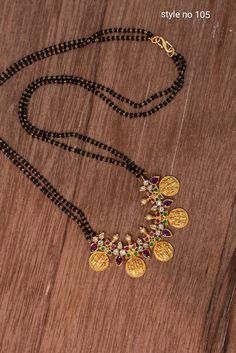 Black beads with ram parivaar Gold Mangalsutra Designs, Gold Earrings Designs, Necklace Designs, Gold Designs, Gold Chain Design, Gold Jewellery Design, Bridal Jewellery, Gold Jewelry Simple, Jewelry Model