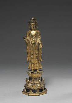 Amita (Amitabha), 700s  Korea, Unified Silla Kingdom (668 - 935)  gilt bronze, Overall: 22.5 x 7.2 x 7.2 cm. This small sculpture shows Amita, the Buddha of the Western Paradise and the focus of the Pure