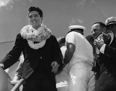 Elvis arrives in Hawaii on March 25, 1961, for his benefit concert for the USS Arizona Memorial.  thanks elvis