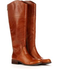 """Round toe tall boot in genuine leather. Features low heel, non-functional zipper detail and side zip closure for entry. Material: Leather. Heel Height: 1 1/4"""" …"""