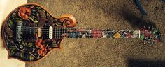 "Guitar Blog: Blueberry highly carved and inlaid ""Floral"" electric guitar with mandolin-shape body"