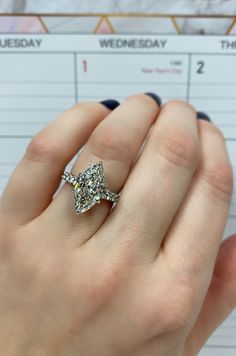 This glittering engagement ring features a 3.01 carat marquise diamond center stone set in 14 karat white gold. #engagementring #marquise #diamond #3carat