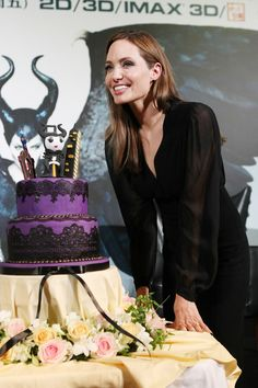 Angelina Jolie is presented with a Maleficent-themed cake, as she continues the promotional tour for the film in Shanghai.