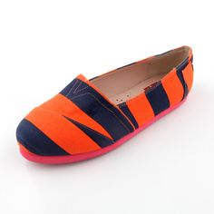 Orange Animal Print Slip ons $44.00 www.lebunnybleu.com