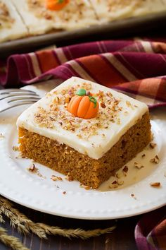 Here's the perfect autumn cake for a crowd...or the family like mine that's obsessed with pumpkin cake! Not only does this Pumpkin Cake with Cream Cheese F