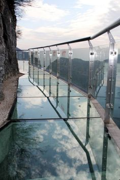 The Walk Of Faith is a glass walkway built off the side of a cliff 1,430 meters in the air. This 60 meter long walk is not meant for the faint of heart.    The path is located on Tianmen Mountain in China's Tianmen Mountain National Forest Park. Would you be brave enough to take the Walk of Faith? NO NO NO NO NO