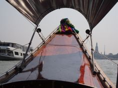 on a dragon longboat going down the Chao Phraya river, Bangkok, Thailand