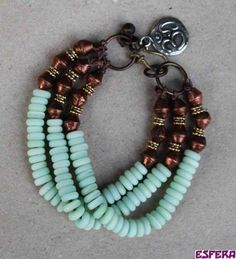 Boho, multi strand, mint green, bracelet with copper beads from Ethiopia and glass rondelles by Esfera jewelry.
