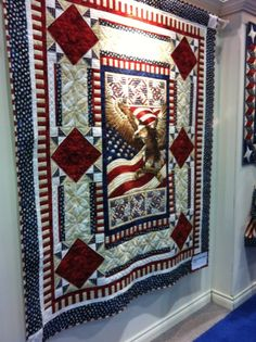 I love patriotic quilts.  This is Stars and Stripes from Northcott, at quilt market.