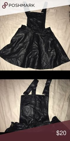 Black leather overall skirt Black leather overall bib skater skirt with pockets & buttons on the side, pockets on the bib. Forever 21 Other
