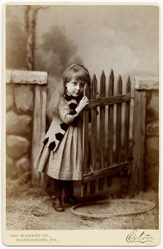 +~+~ Antique Photograph ~+~+  Sweet girl by a gate.  Love the detail on her jacket.  Harrisburg, PA.