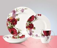 Delicate watercolor renderings of anemones and petunias bring the garden indoors with these plates from Mikasa.