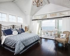 beach-bedroom-high-ceiling-iron-headboard - Home Decorating Trends - Homedit
