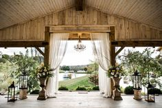 Love the soft drapes, chandelier and tiered lanterns