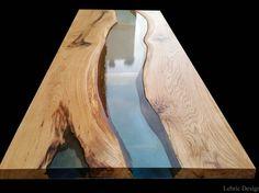 Antico Trentino présente la conception de Lebrìc, la ligne de produits exclusive combinant de diverses essences en bois avec de la résine époxyde la plus de haute qualité. Le dessus de table de Danube est fait de deux insertions en bois et d'une rivière de résine au milieu.