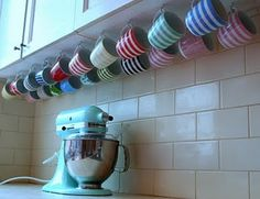 Clever mug storage under cupboards ~ this would free up a lot more cabinet space! Coffee Cup Storage, Mug Storage, Coffee Mug Display, Coffee Cup Holder, Kitchen Organization, Kitchen Storage, Kitchen Decor, Organizing, Do It Yourself Furniture