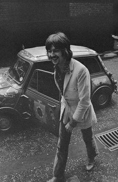 Eric Clapton with George Harrison's Mini