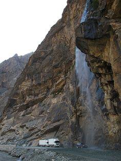 Waterfall washing all cars and trucks passing by a mountain road, Pamir Mountains, Tajikistan. Brunei, Sri Lanka, Laos, Mountain Love, Mountain Range, Nepal, Tian Shan, World Travel Guide, Silk Road