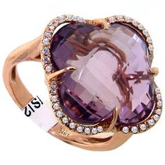 Round diamonds and a 9.50ct. checkerboard amethyst set in 18kt. yellow gold.