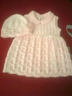 This lacy knit baby dress is so pretty! ~~ Fancy lace pattern from skirt [https://www.pinterest.com/pin/460563499372011326/] repeated on matching beanie with crochet flower; staggered eyelet lace bodice; look for Knitted Picot Border Collar tutorial (garter st). [https://www.pinterest.com/pin/460563499376640513/] ~~ Inspiration only photo ~~ Örgü bebek elbisesi ve şapkası