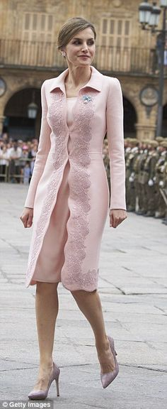 She wore a stylish pink coat with embroidered detail with a matching dress