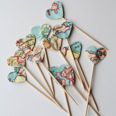 12 Map love heart cup cake toppers. Maps will vary to the ones pictured Perfect to add a little sparkle to any party! Looks great in cupcakes or