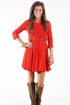 """Ship Came In Dress, Rust $45.00 This dress is such a flattering style! The belt cinches your waist and the pleated skirt gives the dress nice movement! And this rust color is beautiful in the fall! Belt included!   Fits true to size. Miranda is wearing a small.   From shoulder to hem:  Small- 33""""  Medium- 34""""  Large- 35"""""""