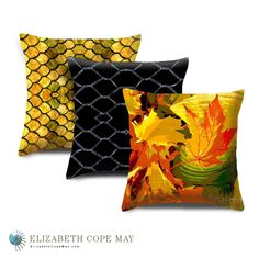 Arrangement of accent/throw pillows: (back to front) Stained Glass, Live Wire, Autumn Leaves.  More pillows at: ElizabethCopeMay.com