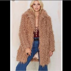 NWT Nasty gal super trash brown long Faux fur coat This is a super trash long faux fur coat bought from nasty gal  it's a size 34 or small it's new with the tag it's a Carmel color Nasty Gal Jackets & Coats Trench Coats