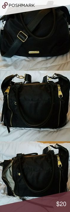 Steve Madden Purse Steve Madden black large size purse, has three outside pockets, two on the sides and one in the middle of the two, see pictures. Its in great condition no rips or problems at all with the outside, the inside has a few ink stains that I tried to show in the pics. Steve Madden Bags Shoulder Bags