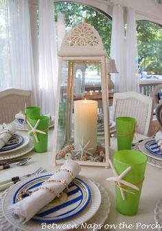 """Minus the chargers, this was truly a budget friendly table setting. The glasses were dollar stores finds, the """"crab"""" plates were from HomeGoods at $4 each. Dinner plates sold at Big Lots for $30. Lantern was a frugal find at Old Time Pottery."""
