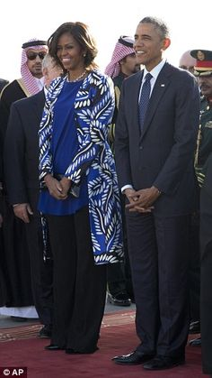 Outfit change: When the president and Mrs Obama left India on Tuesday, she was dressed in a floral dress. Though her husband wore the same suit and polka-dot tie when they landed in Saudi Arabia, Mrs Obama had changed into a long-sleeve coat and slacks to cover up in the conservative Muslim country