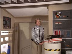 Interior, passenger module of Eagle set from the the television show Space: 1999. Side door and computer module in the passenger module. Barbara Bain in the silver jacket.