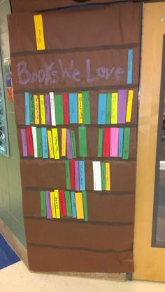 "Literacy night ""Books We Love"" bookshelf. I had parents/teachers/students write down their favorite book on cut strips of cardstock taped up. Big hit!"