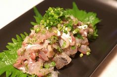 Aji is horse mackerel in Japanese and a kind of fish which you find easily in Japan. Aji no Tataki is another Sashimi dish made with Tataki method.