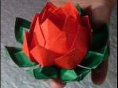 How to make an origami Lotus Flower. Good grief this origami lotus flower looks like a lot of work but it sure turns out nice. They are used to decorate the Loy Krathong boats. Origami Lotus Flower, Origami Rose, Origami Paper, 3d Paper, Tutorial Origami 3d, Origami Flowers Instructions, Origami Modular, Fabric Flowers, Paper Flowers