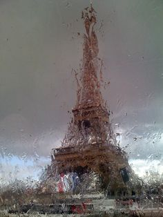 un jour de pluie....<3....through the pouring rain, I see the bewitching tower - as it stands proudly - beckoning lovers and those who seek to be loved. ~ rebeca amparo