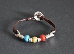 unisex leather bracelet-fish tail bracelet-uno no de 50-button clasp bracelet-vintage bracelet-old beads bracelet-minimalist bracelet by OtroAccesorio on Etsy