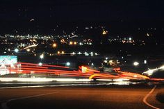 March 14, 2013 --  In Great Plains, if you drill it they will come -- In a time exposure photo, tractor-trailers leave streaks of light as they merge onto Highway 2 west of Williston, N.D. Williston, the center of the energy boom in North Dakota, is the fastest-growing small city in the US.  Larry Mayer/Billings Gazette/AP/File