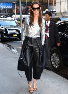 Katie Holmes wore a silver long-sleeve shirt and leather culottes to Good Morning America.