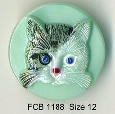 Cat button light green Czech glass with black and white cat   - size 12, 27 mm FCB 1188 by buttonsandshanks on Etsy