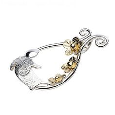 Sterling silver brooch with three 18k gold vermeil flowers and fairy child.  Metal: Silver