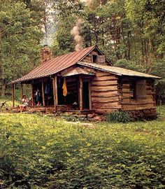 Log cabin in the woods.