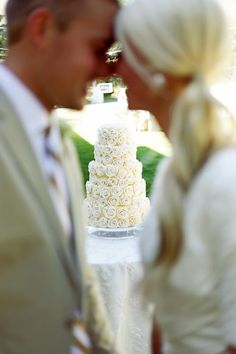 A different way of taking a cake picture besides actually standing next to it or cake cutting