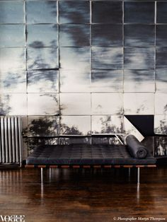 voguelivingmagazine:    A Mies van der Rohe Barcelona daybed sits in front of photographer Martyn Thompson's 'Tree' photographs, reproduced in 42 sections on newsprint. Thompson's latest exhibition, hosted by Dinosaur Designs, opens this week in Sydney.  Martyn Thompson: Plant Life, 1 February - 9 February (closed Sunday 5 February), Dinosaur Designs, 585 Elizabeth Street, Strawberry Hills NSW.  Photograph by Martyn Thompson, originally published in Vogue Living Nov/Dec 2011.