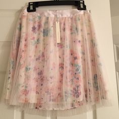LC Lauren Conrad Floral Skirt Pretty pink floral skirt! Brand new with tags attached, never worn. LC Lauren Conrad Skirts Mini