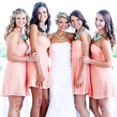 The look of my bridesmaids....Hair down, coral dresses, a little more green than blue necklaces though!