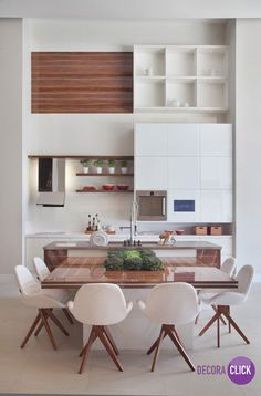 do dia: ilha do chef White Modern kitchen with integrated dining.White Modern kitchen with integrated dining. Kitchen Interior, New Kitchen, Kitchen Dining, Kitchen Decor, Kitchen Layout, Kitchen Modern, Kitchen Ideas, Kitchen Wood, Modern Kitchens