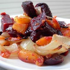 "Roasted Beets 'n' Sweets | This has been s big hit each time I made it for ""crowds"" big and small. This is a great recipe for those that don't like sweet potatoes; the beet and onion medley tones down the sweetest of the sweet potatoes and turns it into a sweet and savory dish."""