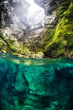 Canyoneers rappel down in the 'Grlja', the most difficult canyon of Montenegro, in the Prokletije Mountains, Montenegro. Photo: Predrag Vuckovic